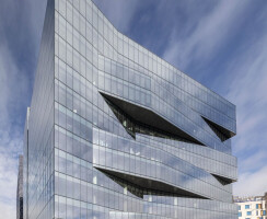 The East side, in the Boston Harbor, shows its two story undulating triangular bays that shift and slide between each other creating a sense of depth and constant movement that changes throughout the length of the day.