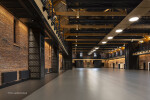 Skyfold movable wall in ceiling pocket to enlarge event space and venue