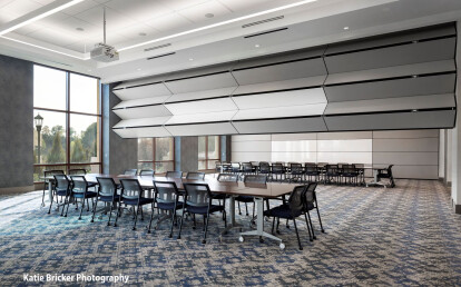 Skyfold Classic movable wall folding from the ceiling automatically to sub-divide conference room