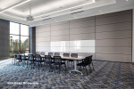 Skyfold movable wall sub-dividing an office boardroom