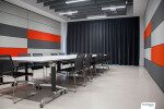 Two Skyfold movable walls sub-dividing an office space to make a flexible meeting room