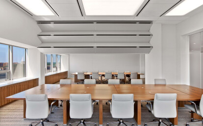 Skyfold Classic movable wall deploying from the ceiling to sub-divide a meeting room
