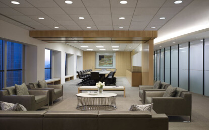 Skyfold Classic movable wall folded in ceiling pocket to transform boardroom and reception area into one large space