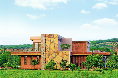 Merging with the Context: Wall cladding designed to resonate with the background of quarried rock on the Aravali Range.