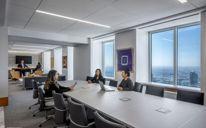 Zenith® retracted in ceiling pocket to enlarge the conference room