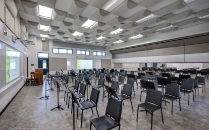 Zenith® automatically descending from ceiling pocket to sub-divide a music room
