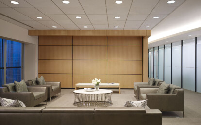 Skyfold Classic movable wall in a wood veneer finish sub-dividing a reception area from a boardroom