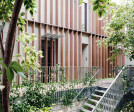 Sunken Atrium - Timber fins were able to increase privacy, reduce hot east/west sun into apartments and a way to humanise the scale of the building with softer natural elements.