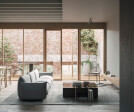 Living Space and Terrace - The building's internal spaces feature a softness in material and familiar details like the timber swing doors to the terrace and kitchen island bench.