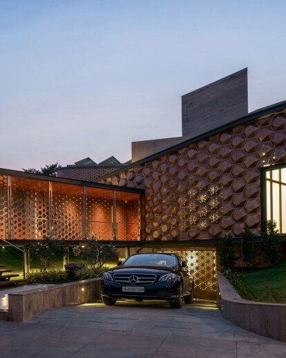 Biomimicry informs the solar sensor-based façade of this intelligent, adaptable family home