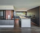 Kitchen island, wall and ceiling cladding made from dade ROC high-performance concrete.
