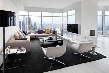 LIVING ROOM: B&B Italia sofa; carpet by Kasthall; lamp by Flos; coffee table and side table by B&B Italia; custom TV Stand by Giusi Mastro.