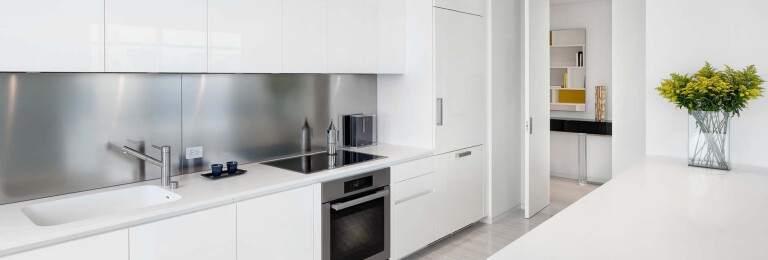 KITCHEN by Boffi: glossy polyester lacquer cabinets; counters in Corian; backsplash in stainless steel. Flooring by LV Wood.