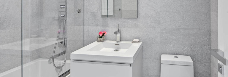 """GUEST BATHROOM: Wetstyle M Vanity and Cube Sink; Hansgrohe """"Citterio"""" single hole faucet in chrome; Duravit Stark 2 Toilet; Hansgrohe Shower System; Dornbracht mirror; shower door system (hardware) by Index D; Stone Spa White Stone Source."""