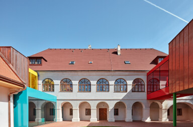 Bold and colourful elementary school additions are playfully incremental
