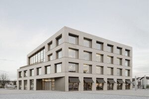 Regularly spaced windows and deep reveals define this discrete new town hall for Remchingen