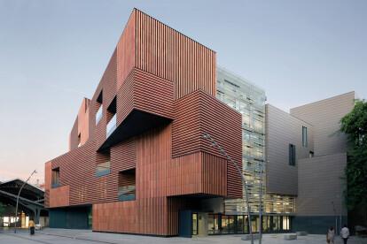 Escola Massana addresses its surrounding context with rotating volumes and ceramic brise-soleil façade