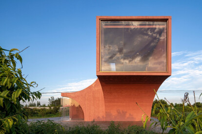 Strongly rooted in site, Peach Hut's form and colour are inspired by surrounding orchard trees