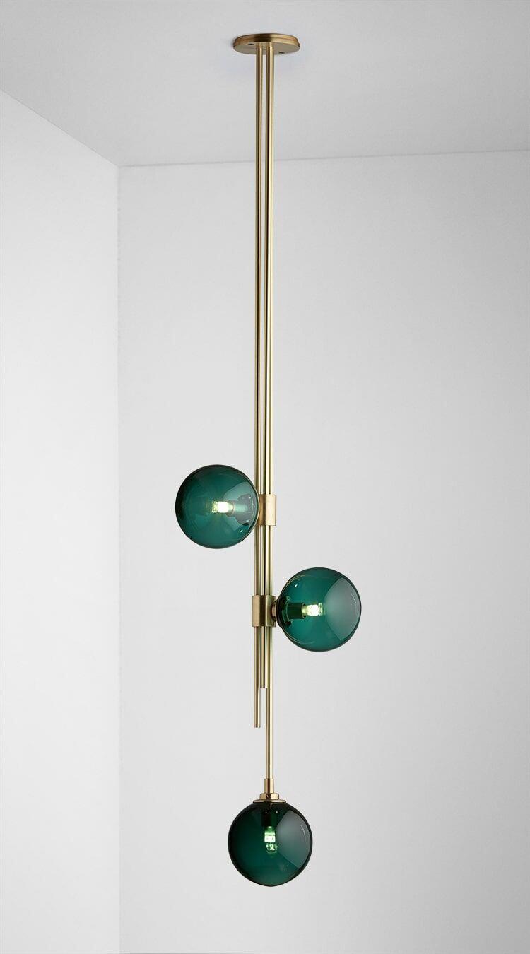 Trilogy Pendant brass with drunken emerald solo