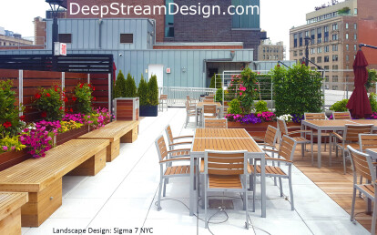 Architectural Tropical Hardwood Screen Wall anchored by integrated Commercial Restaurant Planters
