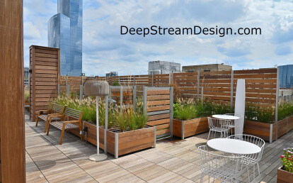 Large Glass and Wood Screen Wall Enclosure anchored by Commercial Planters create a Roof Deck Dog Park with out penetrations