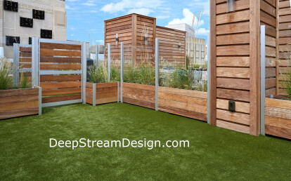 Large Glass and Wood Screen Wall Enclosure with Gates anchored by Commercial Planters create a Roof Deck Dog Park with out penetrations