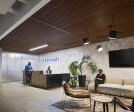 Reception lobby with custom fabricated desk by Synecdoche