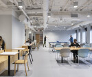 Open part of cafe with flexible seating and games.