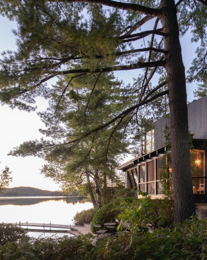 Two eras meet in a fusion between an original log cabin and contemporary addition