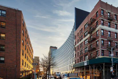 BIG completes curving mixed-use residential project in Harlem