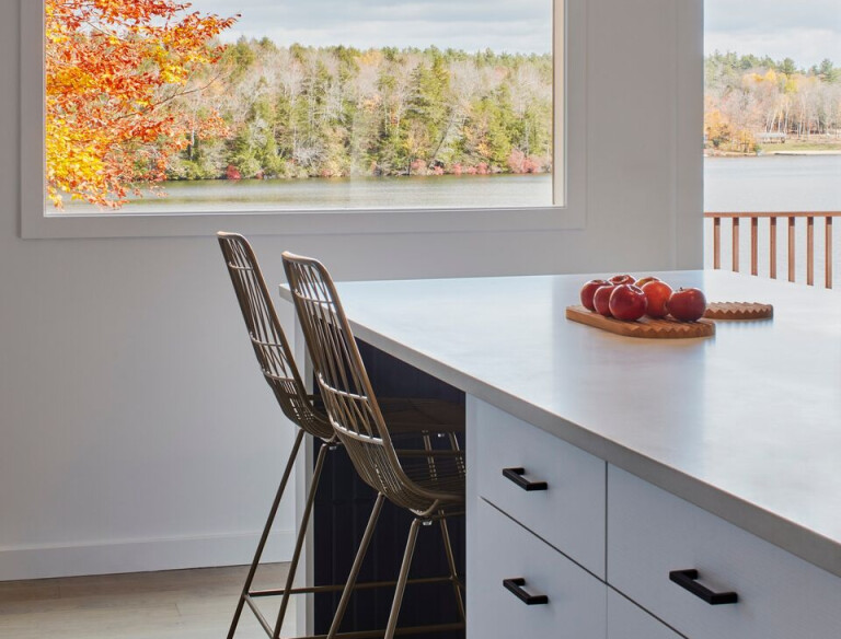 Directly across from the island, we reused a large window the owner found in the basement to open up a new view to the lake
