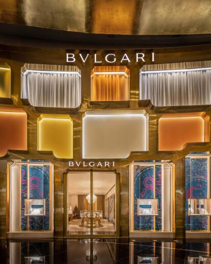 MVRDV frames colored glass in an asymmetric brass pattern for Bulgari Bangkok storefront