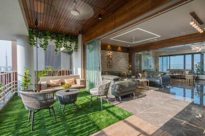 One is welcomed by a refreshing garden balcony that keeps the apartment ventilated throughout the day. The garden entrance is creatively done, distinctive use of wood in flooring and ceiling with little green patch looks mesmerizing.