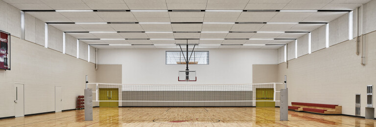 Gymnasium with acoustic ceiling.