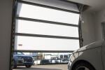 Compact folding door, no overhead rails