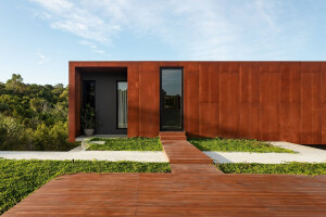 Corten clad home designed with green space in mind