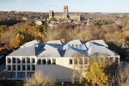 Lower Mountjoy Teaching and Learning Centre responds to its historic context with playful modules and pyramidal roofs