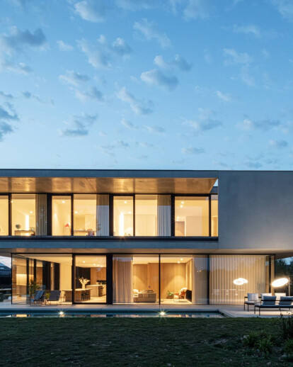 Simple yet dramatic forms and careful siting guide the design of Residence DDE in Belgium