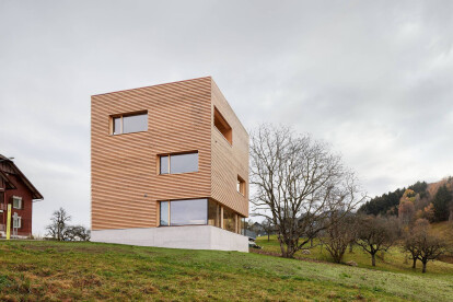 Contemporary design response to surrounding farmhouses results in an expressive new building ensemble