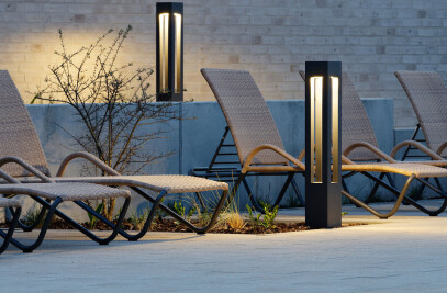 Shielded LED bollard with wide beam light distribution for a high degree of illuminance on the ground surface