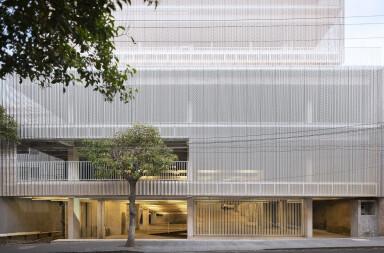 Clean concrete superstructure of Estación San José embraces its urban context