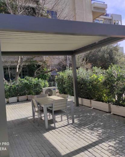 Bioclimatic pergola  in a backyard