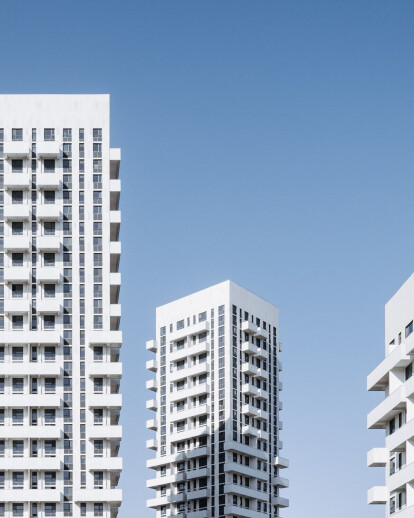 Three elegant white towers by Superimpose stand tall in a new CBD district of Changzhi