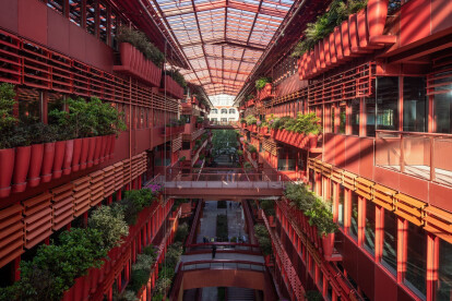 Ateliers Jean Nouvel completes bright red arcade lined with rows of flower pots
