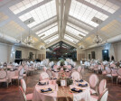 A system of color-changing LEDs above the ceiling throws a color wash onto the translucent Ceilume ceiling panels. The luminous ceiling can match the blue sky, the sunset, or the bridesmaids' gowns.