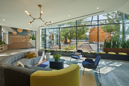 The lobby opens to a outdoor courtyard designed to extend the office for daily use and entertaining.