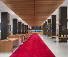 SNFL's ground floor is arranged around an internal street that runs beneath a floating linear canopy of wood beams, from the Fifth Avenue entrance to the welcome desks.