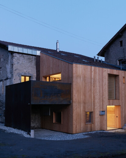 House CCB in Switzerland sees the transformation of a barn into a luminous contemporary residence