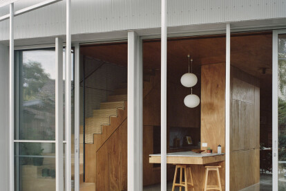 Perforated steel sunshading along the length of the rear verandah provides sun control in summer while still allowing passive heat gain in winter.