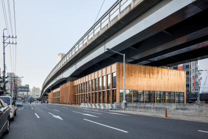 Jong-Am Square in Seoul reinvents neglected urban space beneath an overpass with a spatially dynamic community centre